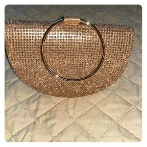 Handbags - Rose Gold clutch with ring handle.